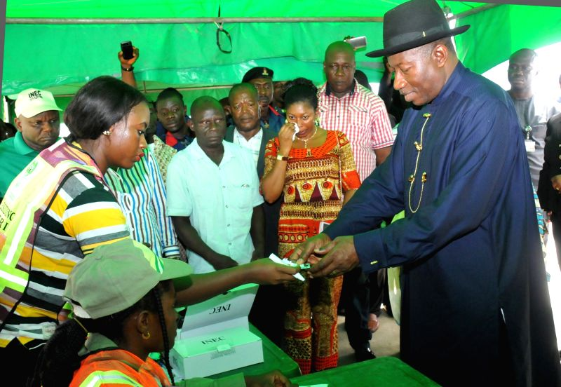 OTUOKE (NIGERIA), March 28, 2015 Nigeria's Peoples Democratic Party (PDP) Presidential candidate, incumbent president Goodluck Jonathan (R), gets registered by election officials before ...