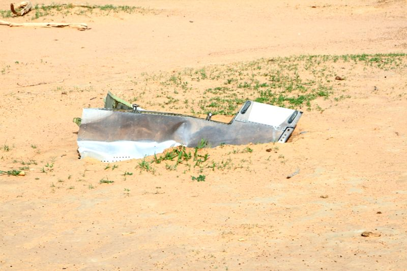 Photo taken on July 25, 2014 shows the crash site of the Air Algerie Flight AH 5017, in Mali's Gossi region. The second black box of the aircraft has been ...