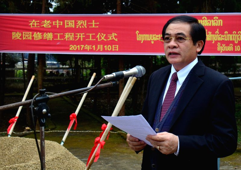 OUDOMXAY, Jan. 10, 2017 - Lao Minister of Labor and Social Welfare Khampheng Saysompheng addresses the renovation ceremony of the Chinese Cemetery in Oudomxay's Na Mor district, Laos, Jan. 10, 2017. ...