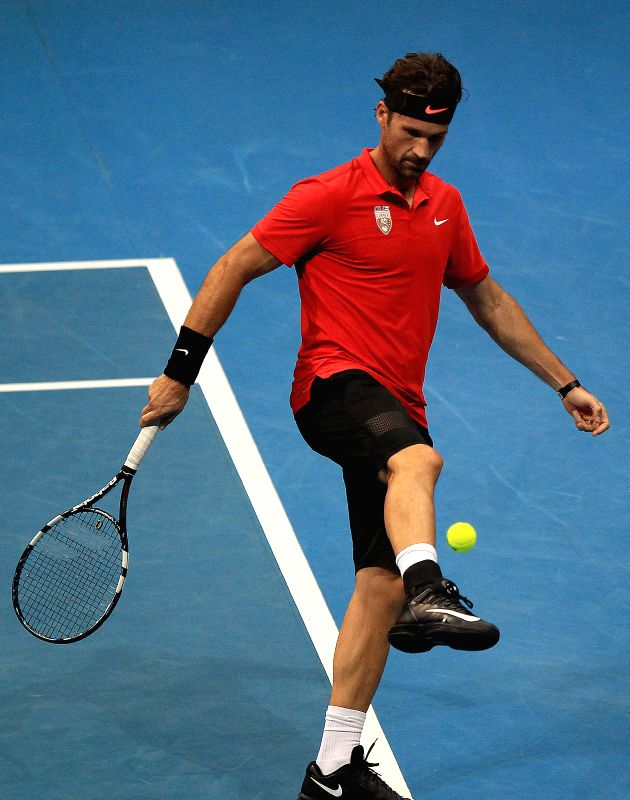 OUE Singapore Slammers' player Carlos Moya of Spain kicks the ball during his match against Obi UAE Royals' player Goran Ivanisevic of Croatia in the ...