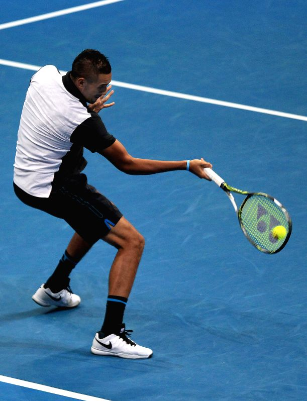 OUE Singapore Slammers' player Nick Kyrgios of Australia returns the ball against the Obi UAE Royals' player during their mixed doubles match in the International ...
