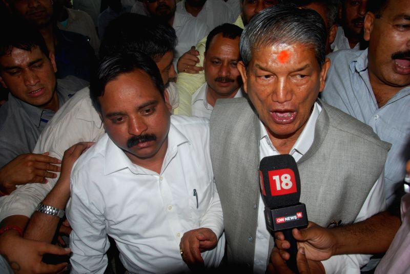 Ousted Uttarakhand Chief Minister Harish Rawat with rebel BJP MLA Bhim Lal Arya talking to media after taking the floor test to prove his party`s majority outside the assembly in Dehradun ... - Harish Rawat