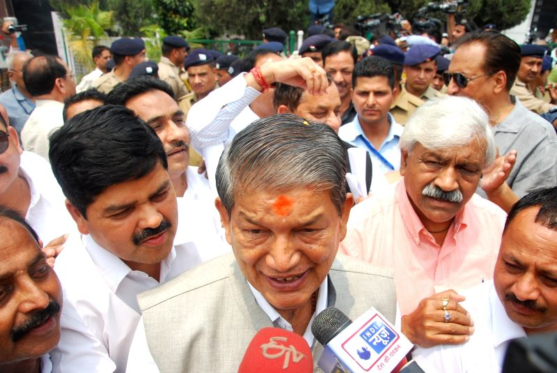 Ousted Uttarakhand Chief Minister Harish Rawat talking to media after taking the floor test to prove his party`s majority outside the assembly in Dehradun on May 10, 2016. - Harish Rawat