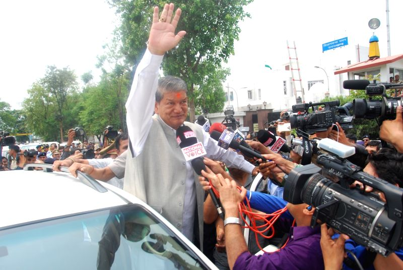 Ousted Uttarakhand Chief Minister Harish Rawat greeting supporters after taking the floor test to prove his party`s majority outside the assembly in Dehradun on May 10, 2016. - Harish Rawat