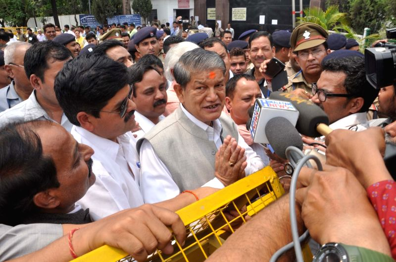 Ousted Uttarakhand Chief Minister Harish Rawat talks to press after winning the trust vote in the state assembly in Dehradun on May 10, 2016. - Harish Rawat