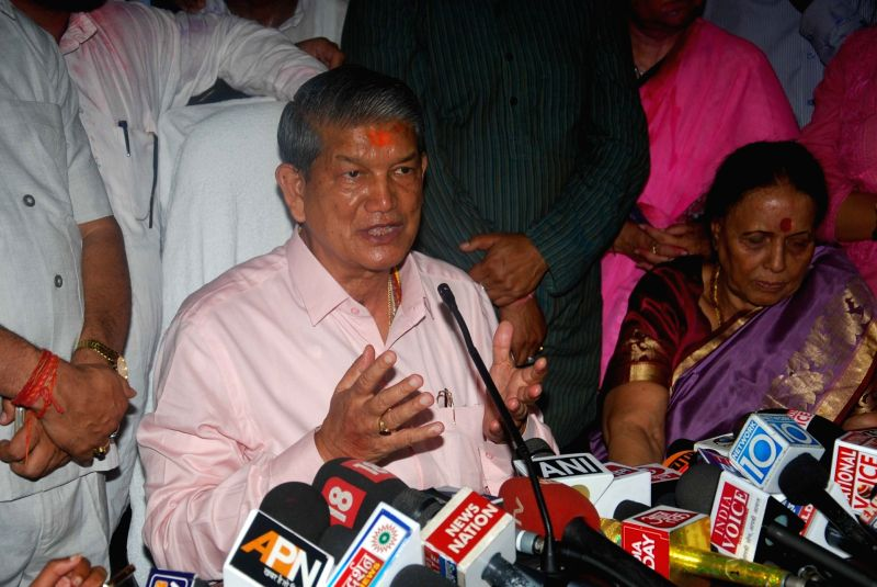 Ousted Uttarakhand Chief Minister Harish Rawat addresses a press conference in Dehradun on May 11, 2016. The central government told the Supreme Court that Rawat had the legislative ... - Harish Rawat