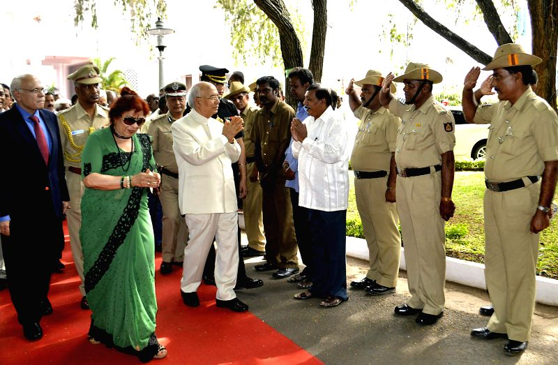 Out-going Karnataka Governor HR Bharadwaj being greeted by Rajbhavan police and staffs at Raj Bhavan, in Bangalore on June 28, 2014.