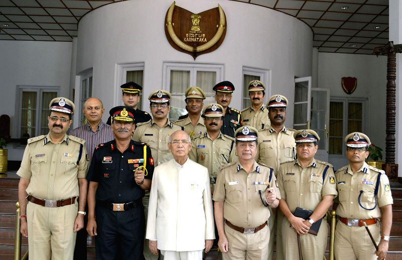 Out-going Karnataka Governor HR Bharadwaj with Senior Police Officials at Raj Bhavan, in Bangalore on June 28, 2014.