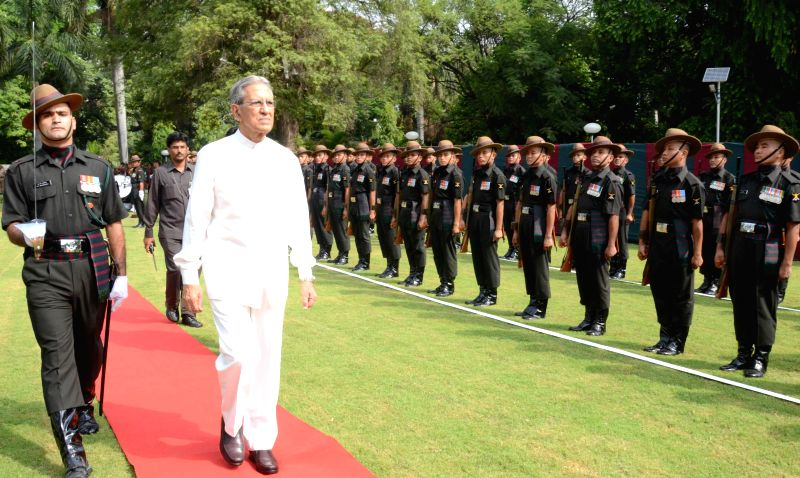 Outgoing Governor of Uttar Pradesh B.L Joshi being given Guard of Honour by the army in Lucknow on June 23, 2014.