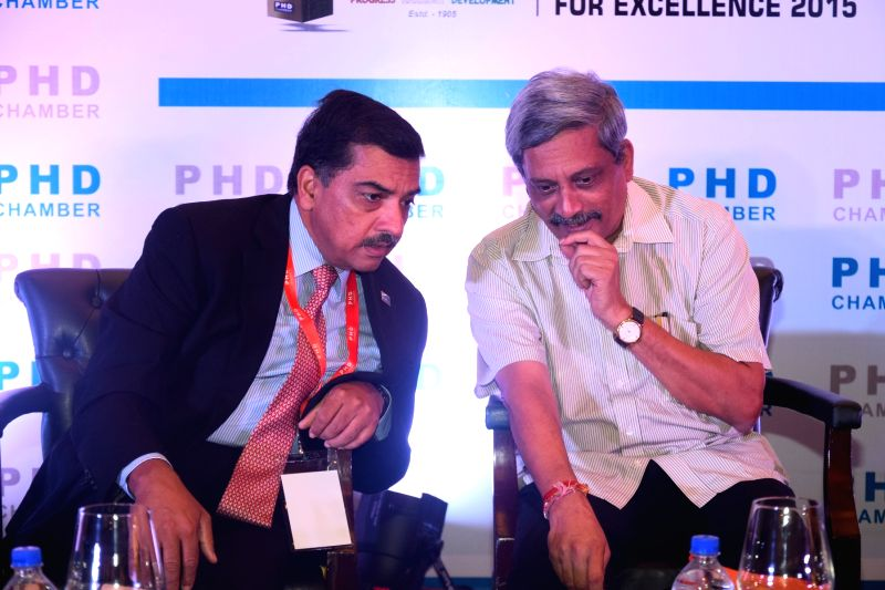 Outgoing President PHD chamber Alok B Shriram with Union Defence Manohar Parrikar  at 110th AGM of PHD Chamber in New Delhi, on Nov 28, 2015.