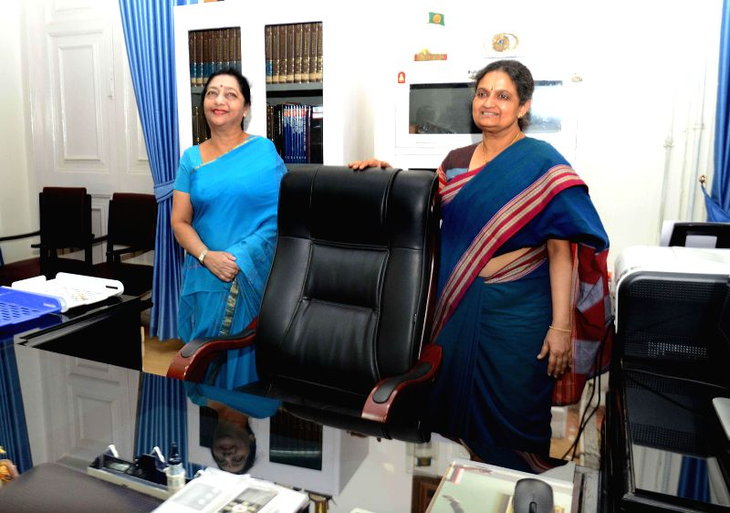 Outgoing Vice Chancellor of Presidency University Malabika Sarkar (L) hand over the charge to Anuradha Lohia (R) at the University in Kolkata on May 2, 2014.