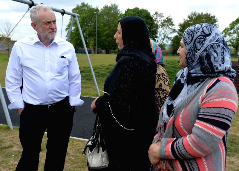 OXFORD (BRITAIN), May 4, 2017 Britain's Labour Party leader Jeremy Corbyn (L) meets local women as he visits local parliamentary candidate Anneliese Dodds in Oxford, Britain on May 4, ...