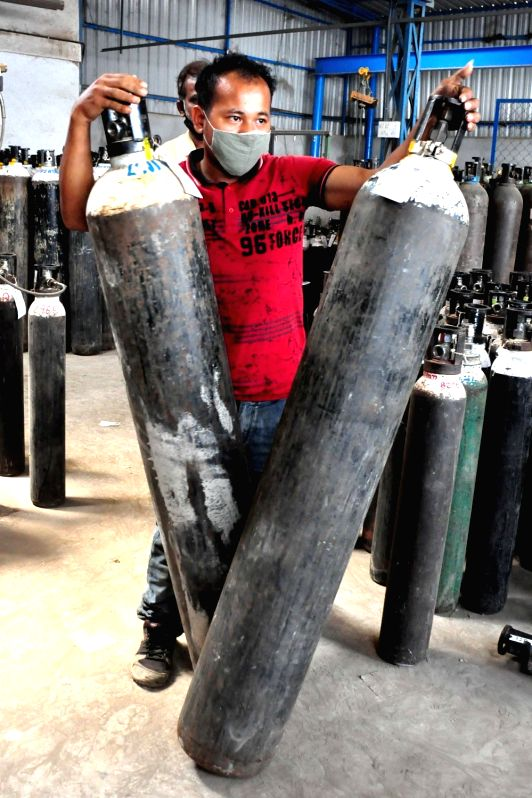 Oxygen cylinders at Universal oxygen unit Peenya due to surge in covid-19 during Coronavirus pandemic , in Bengaluru on Tuesday 20th April 2021.(Photo: Dhananjay Yadav/IANS)