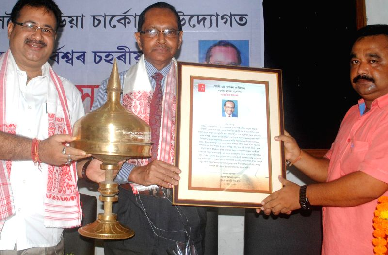 Padmashree Dr. Sarbeshwar Sahariah being felicitated by members of Mangaldai Media Circle during a programme organised at the press club in Guwahati on June 23, 2014.