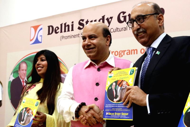 "Pakistan High Commissioner Abdul Basit with BJP leader Vijay Jolly at the launch of ""India-Pakistan Relation"" - a booklet, in New Delhi, on May 30, 2016."