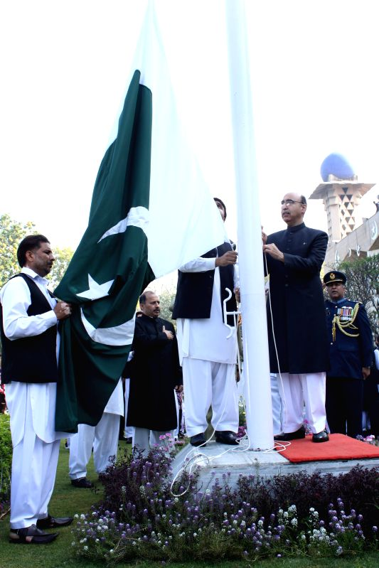 Pakistan High Commissioner to India Abdul Basit hoists the Pakistani flag during a programme organised at Pakistan High Commission in New Delhi on Pakistan National Day in New Delhi, on March 23, ...