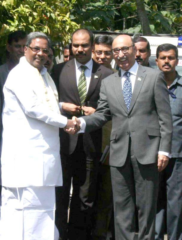 Pakistan High Commissioner to India Abdul Basit meets Karnataka Chief Minister Siddaramiah in Bengaluru, on Oct 29, 2015. - Siddaramiah
