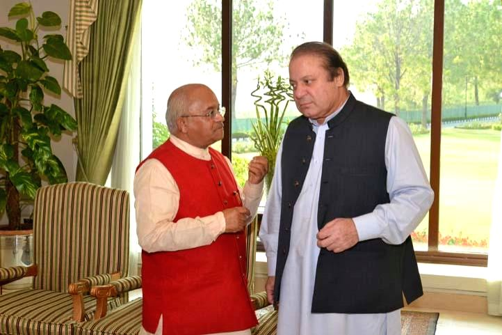 Pakistan Prime Minister Nawaz Sharif during a meeting with Chairman of Council for Indian foreign Policy and and former editor of Press Trust of India Dr V P Vaidik at Prime Minister's House in ...