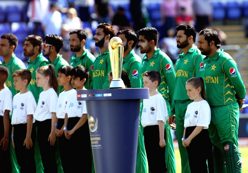 Pakistani cricketers stand for national anthem ahead of the first Semi-final match of ICC Champions Trophy between England and Pakistan at Sophia Gardens in Cardiff, Wales, Britain on June ... - Surjeet Yadav