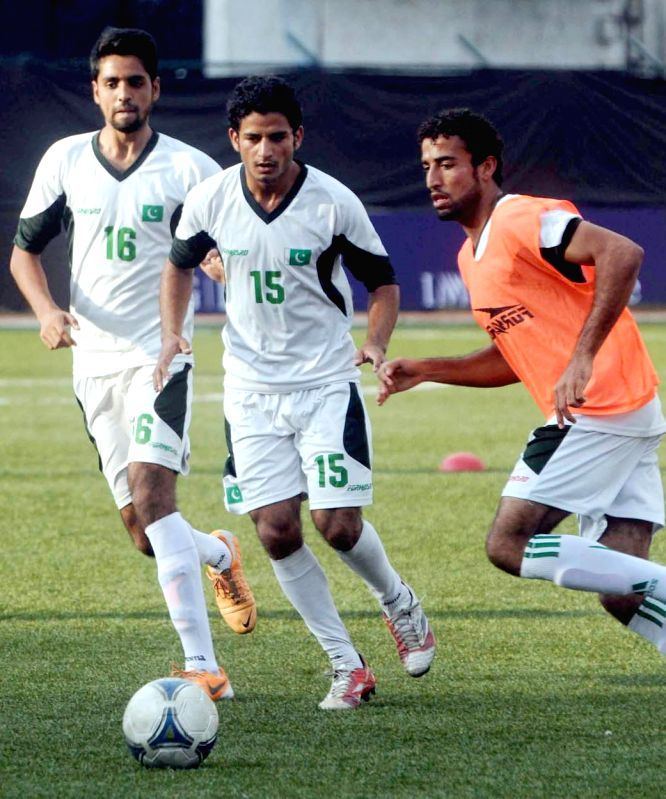 Pakistani footballers during a practice session at Bangalore Football Stadium in Bangalore on Aug 19, 2014.