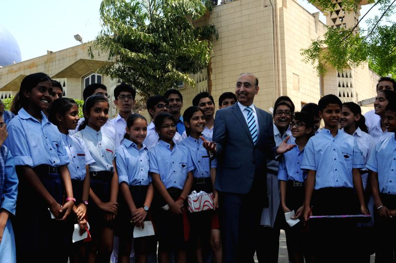 `Pakistani High Commissioner to India Abdul Basit with 30 Indian students participating in 'Exchange for Change' at Pakistan High Commission in New Delhi on April 28, 2014.