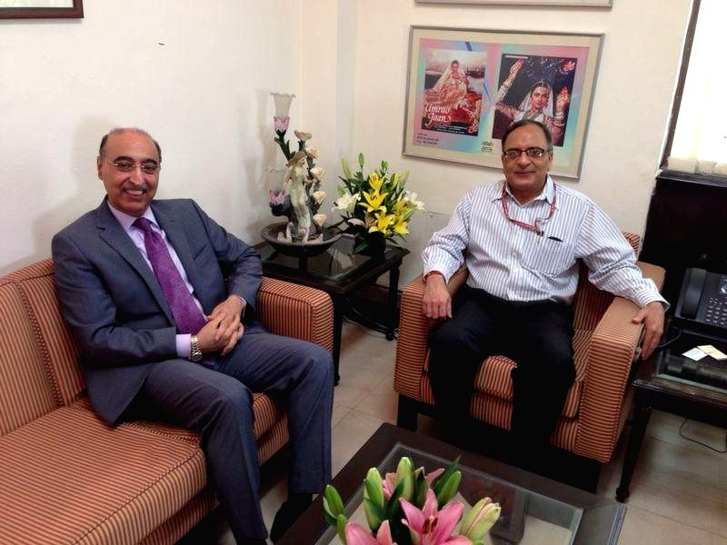 Pakistani High Commissioner to India, Abdul Basit during a meeting with Information and Broadcasting Secretary Bimal Julka in New Delhi on May 6, 2014.