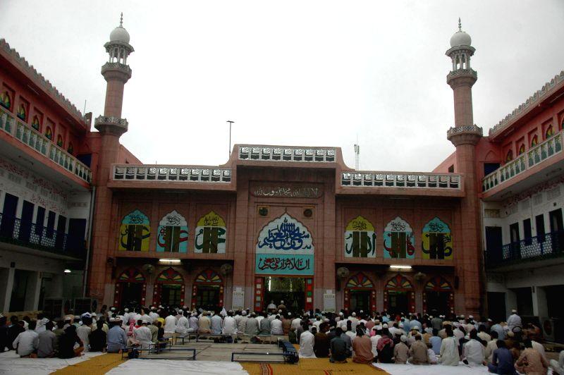 Pakistani Muslims offer prayers to celebrate the Eid al-Fitr festival in eastern Pakistan's Lahore, on July 18, 2015.