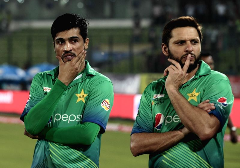 Pakistani players Mohammad Amir and Shahid Afridi. (Photo: Surjeet Yadav/IANS)