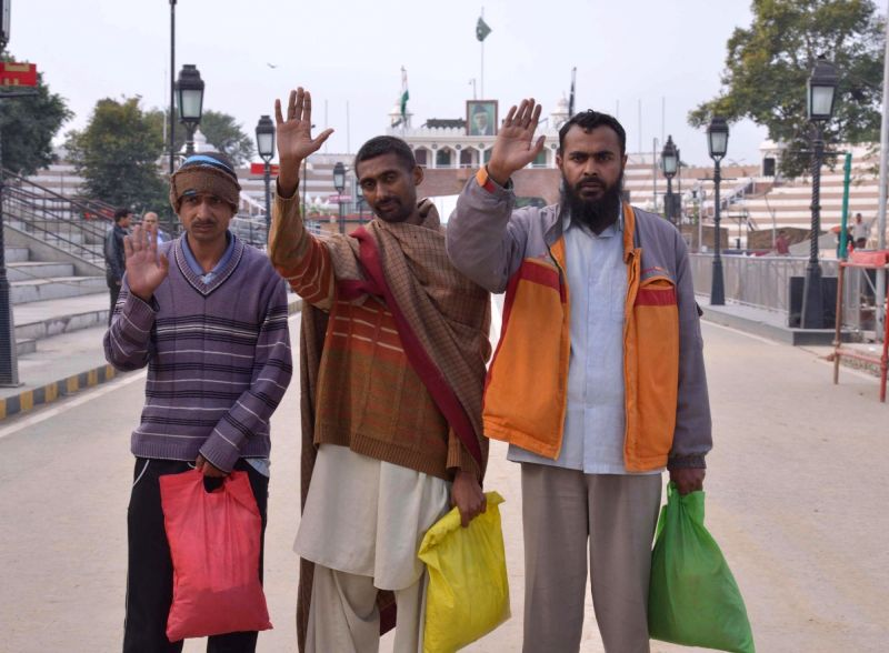 Pakistani prisoners who were released from Indian jails head towards their homes via Attari-Wagha border in Punjab on Dec 11, 2015.