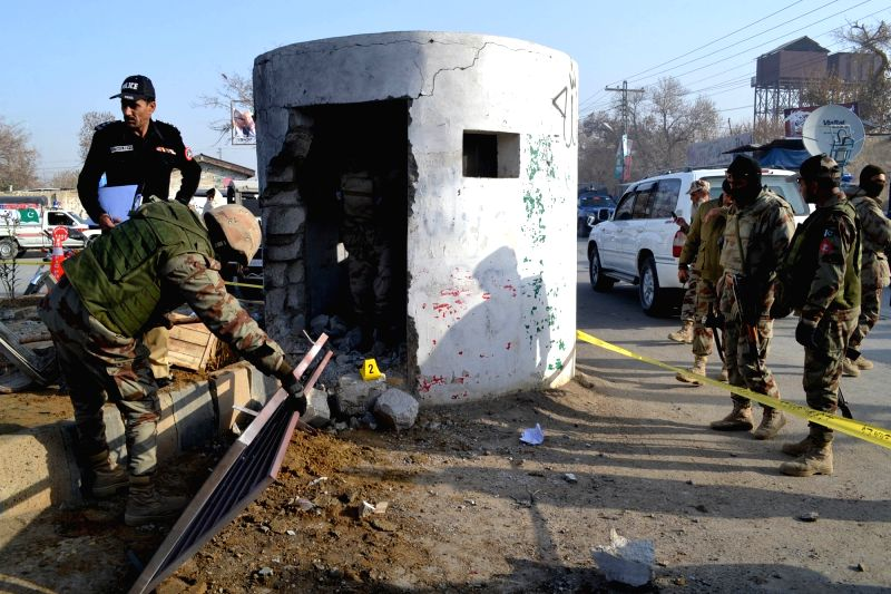 Pakistani security personnel inspect the site of a bomb blast in southwest Pakistan's Quetta, Dec. 12, 2015. At least one security officer was killed and four ...