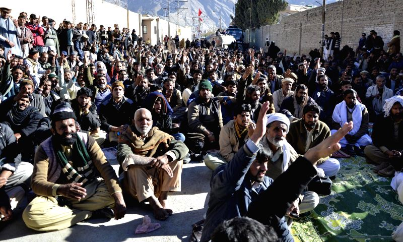 Pakistani Shiite Muslim pilgrims shout slogans during a protest in southwest Pakistan's Quetta on Nov. 27, 2015. Pakistani Shiite pilgrims staged a protest to demand ...