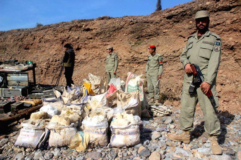 Pakistani soldiers display seized explosives to media near northwest Pakistan's Peshawar on Nov. 18, 2015.