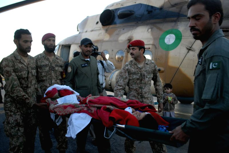 Pakistani soldiers transfer an injured woman after the severe earthquake in northwest Pakistan's Peshawar, Oct. 27, 2015. Pakistani Information Minister Pervaiz ... - Pervaiz Rashid