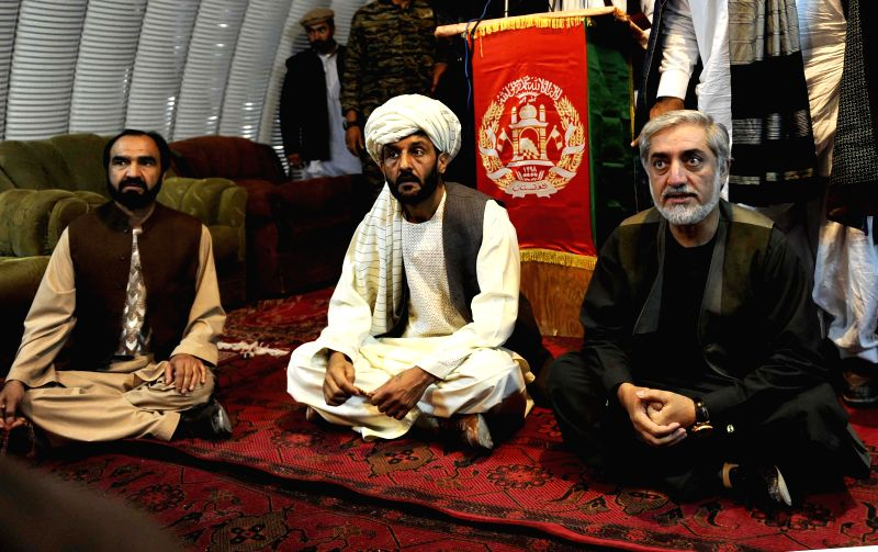 Afghan presidential candidate Abdullah Abdullah (R) speaks to family members of victims of suicide bomb blast in Paktika province, Afghanistan, July 20, 2014. Days .