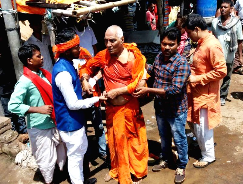 ": Pakur: Injured Social activist Swami Agnivesh being taken to the hospital after suspected Bharatiya Janata Yuva Morcha (BJYM) activists thrashed him while shouting ""Jai Shri Ram"" slogans in ..."
