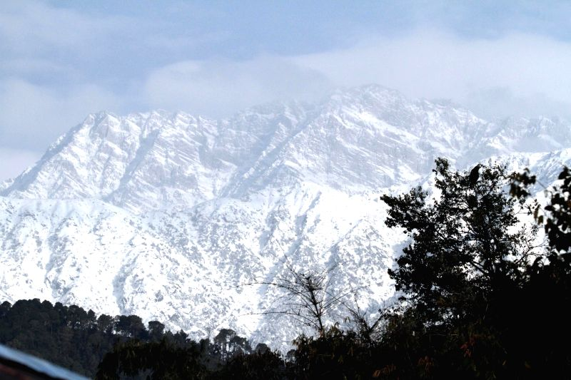 A view of snow clad Dhauladhar range from Palampur in Himachal Pradesh on Dec 15, 2014.