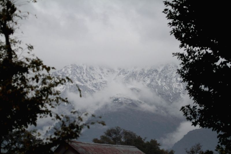 Heavy snow fall on Dhauladhar range seen from Palampur as the range received fresh snow fall since last night on Jan 3, 2015.