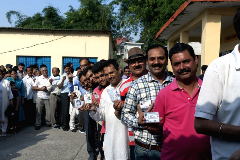 Palampur: People queue-up to cast their votes during the seventh and the last phase of 2019 Lok Sabha Elections at a polling booth in Sughar village of Himachal Pradesh's Palampur on May 19, 2019.