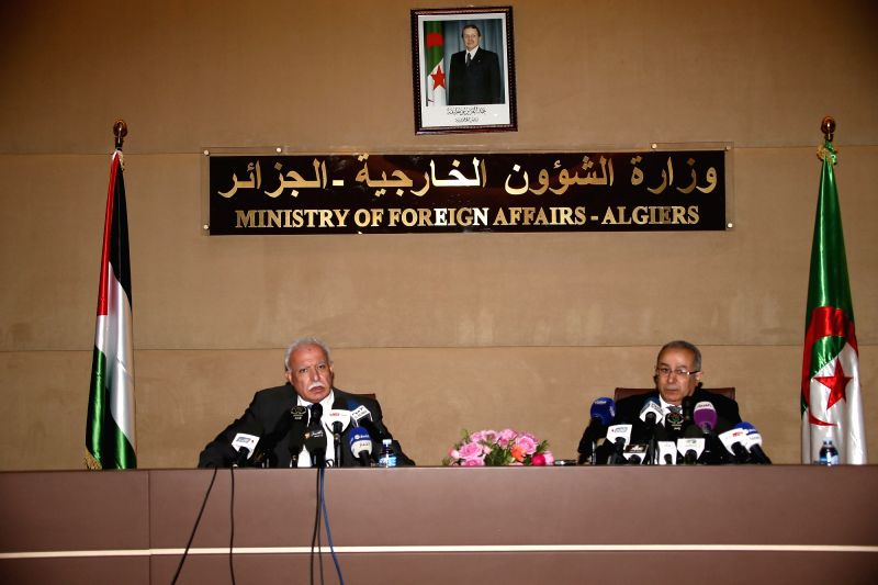 Palestinian Foreign Minister Riyad al-Maliki (L) and his Algerian counterpart Ramtane Lamamra (R) attend a press conference in Algiers, Algeria, on Nov. 25, 2015. ... - Riyad and Malik