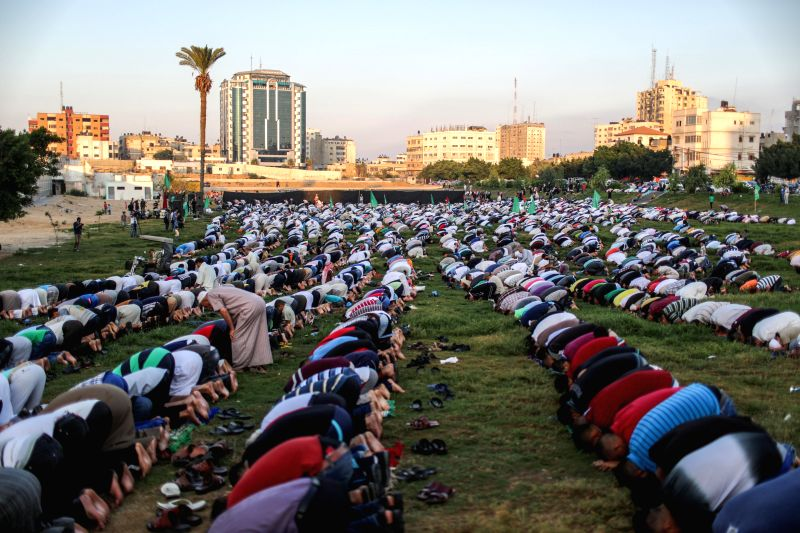 Palestinians attend Eid Al-Fitr prayers in Gaza City on July 17, 2015.