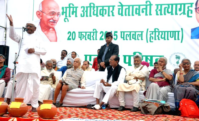 Social activist Anna Hazare addresses a farmers' rally in Palwal district of Haryana on Feb 20, 2015. He will be marching from Palwal to Jantar Mantar, New Delhi to protest against the ...