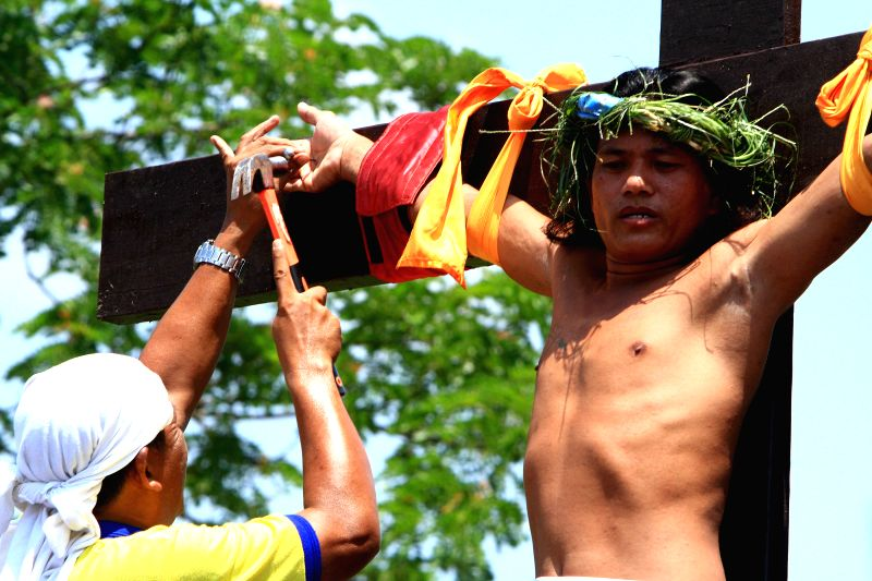 Devotee Ernesto Palmar participates in a re-enactment of the crucifixion of Jesus Christ on Good Friday in Pampanga Province, the Philippines, April 18, .