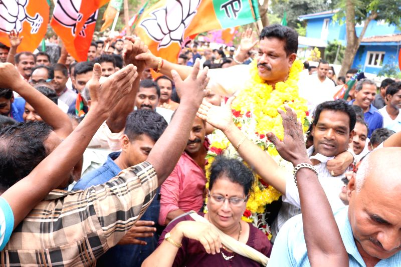 Panaji: BJP's Dayanand Sopte celebrates with party workers after emerging victorious in the Mandrem bypoll, in Panaji on May 23, 2019. (Photo: IANS)