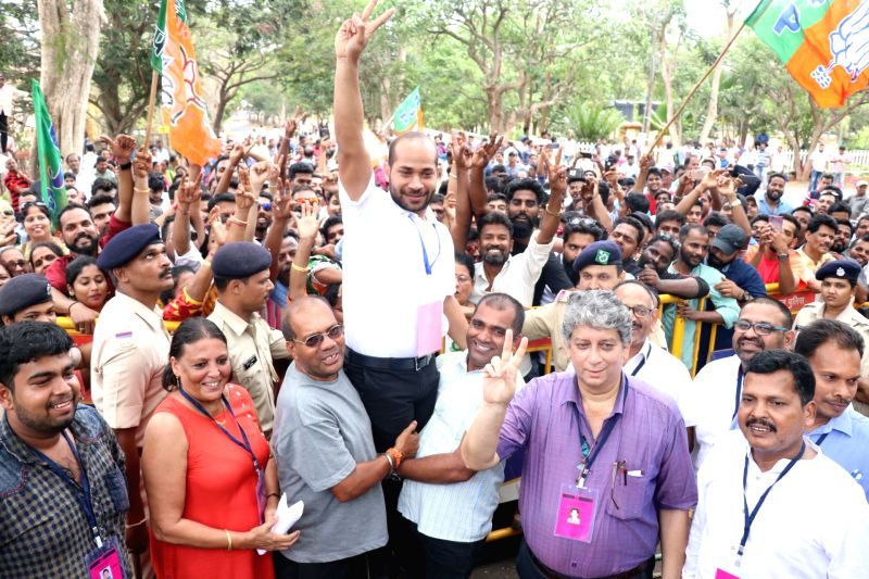 Panaji: BJP's Joshua D'Souza celebrates with party workers after winning the Mapusa Assembly bypoll, in Panaji on May 23, 2019. (Photo: IANS)