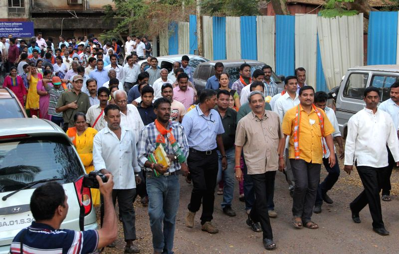 Defense Minister Manohar Parrikar was seen campaign for BJP`s candidate Sidharth Kunkolikar ahead of the Panaji By Poll elections to be held on 13th Feb in Panaji on Feb 5, 2015.