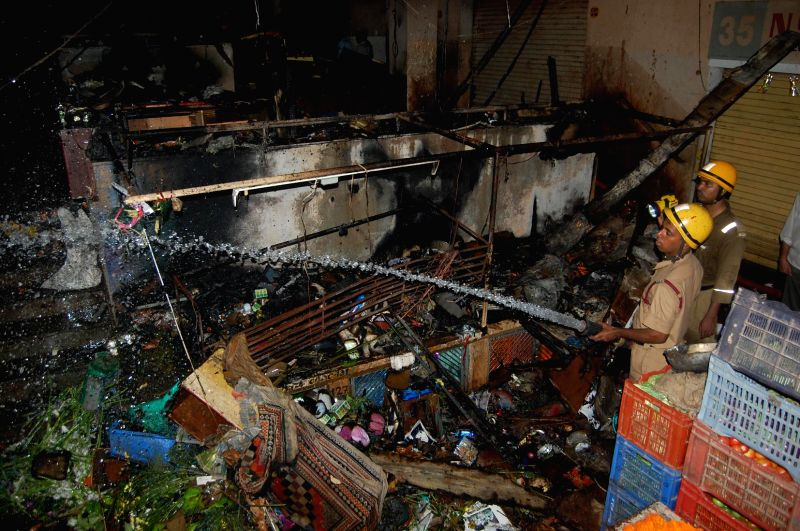 Firefighters douse a fire that broke out at Panaji Municipal Market on Dec 22, 2014.