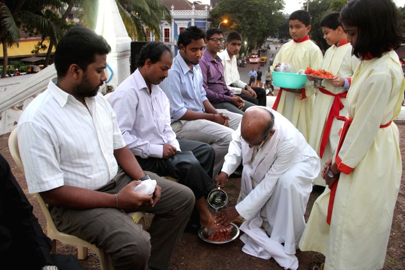 Fr. Cleto Pereira of Our Lady of Immaculate Conception Church washes the feet of Christian devotees on the eve of Good Friday in Panaji, on April 2, 2015.