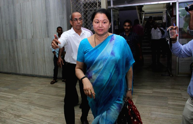 Mining magnate Radha S. Timblo arrives to appear before the Enforcement Directorate (ED) at Patto, in Panaji on Nov 18, 2014. Timblo, was named by the central government, in its affidavit, ...