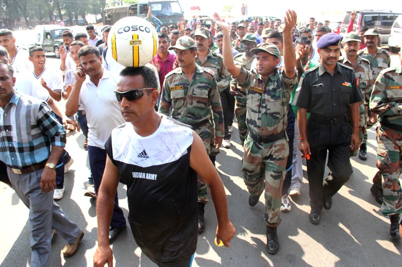 Naib Subedar Azad Singh of 2 STC Goa walks with a football on his head on Vijay Divas in Panaji on Dec 16, 2014. The soldier at a stretch walked 43 km with the ball on his head.