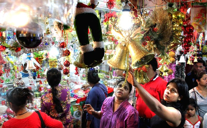 People busy with Christmas shopping in Panaji, Goa on Dec 23, 2014.